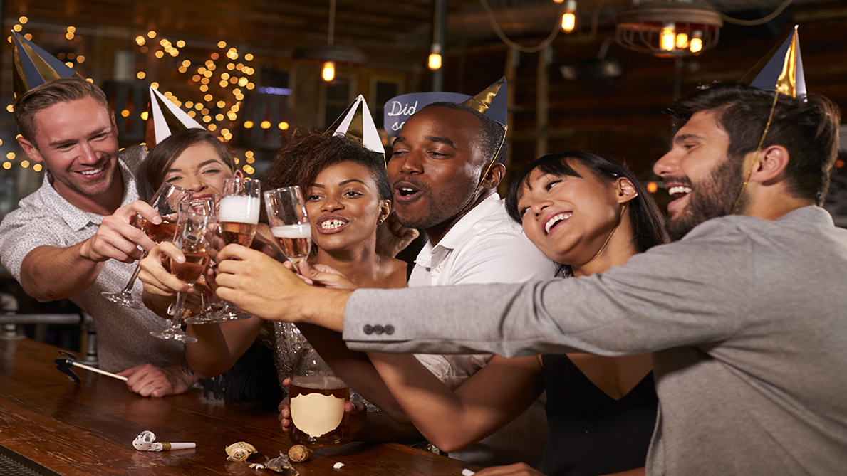 Friends toasting with champagne at New Year party in a bar | One Law ...