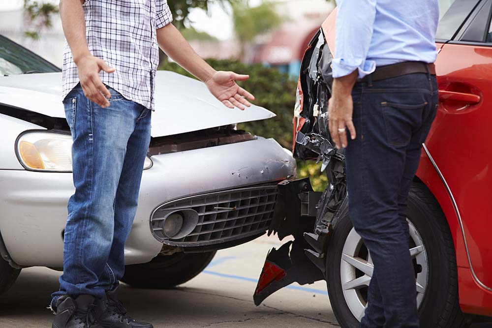 Two men talking after minor accident