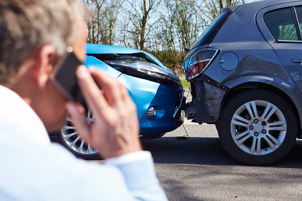 Man making phone call after minor car accident