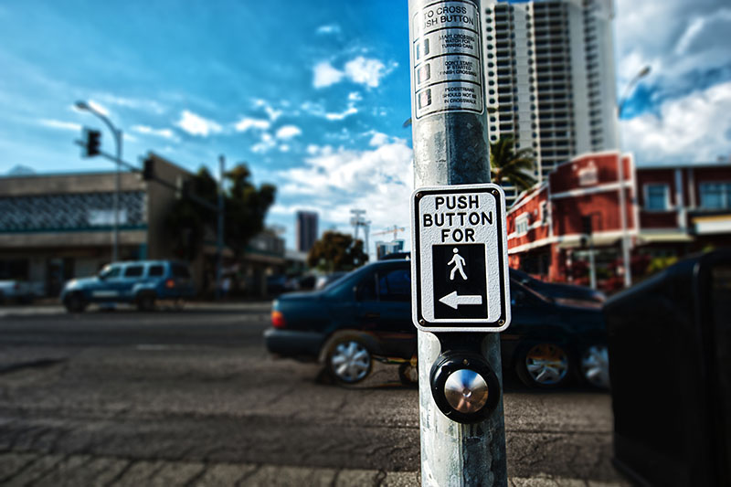 Crosswalk button | One Law Group